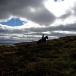 Michelle and Honey on Cnoc an cairn by Dingle Horse Riding